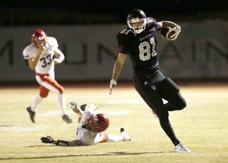 Scottsdale Desert Mountain wide receiver #81 Mark Andrews runs for a first down after breaking a tackle by Mesa Mountain View's Connor Ipsen played at Desert Mountain High School in Scottsdale, AZ. PHOTO COURTESY ARIZONA REPUBLIC Rob Schumacher