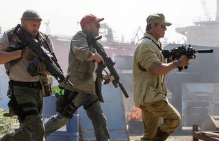 """(From left to right) Randy Couture is Toll Road, Jason Statham is Lee Christmas and Sylvester Stallone is Barney Ross in """"The Expendables 3."""" (Phil Bray, Lionsgate)"""