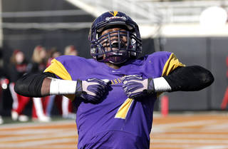 Anadarko's Tramayne Wauahdooah celebrates a play during the Class 4A State Football Championship game between Anadarko and Poteau at Boone Pickens Stadium in Stillwater, Okla. Photo by Sarah Phipps, The Oklahoman SARAH PHIPPS