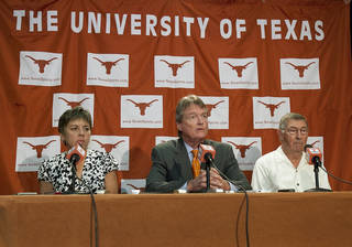 Texas officials speak during a news conference Tuesday, June 15, 2010, in Austin, Texas, about the university staying in the Big 12. From left are women's athletic director Chris Plonsky, university president William Powers Jr. men's athletic director DeLoss Dodds. (AP Photo/Austin American-Statesman, Laura Skelding) ** MAGS OUT NO SALES TV OUT INTERNET: AP MEMBER NEWSPAPERS ONLY ** ORG XMIT: TXAUS205
