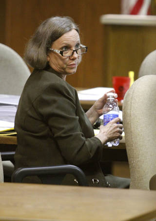 Rebecca Bryan takes a break during jury selection Tuesday in the Canadian County Courthouse in El Reno. Photo by Steve Gooch, The Oklahoman Steve Gooch - The Oklahoman