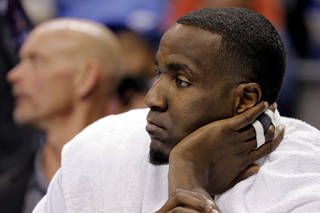 Oklahoma City's Kendrick Perkins (5) watches the game from the bench during the NBA basketball game between the Oklahoma City Thunder and the Dallas Mavericks at Chesapeake Energy Arena in Oklahoma City, Okla. on Wednesday, Nov. 6, 2013. Photo by Chris Landsberger, The Oklahoman