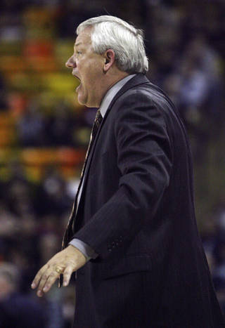 Mercer head coach Bob Hoffman yells to his players against Utah State during the CollegeInsider.com college basketball tournament championship game, Wednesday, March 28, 2012, in Logan, Utah. Mercer won 70-67. (AP Photo/The Salt Lake Tribune, Kim Raff) DESERET NEWS OUT; LOCAL TV OUT; MAGS OUT