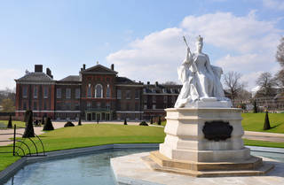 A statue of Queen Victoria greets visitors to her birthplace in central London--Kensington Palace. (photo: Cameron Hewitt)