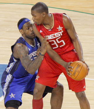 Kevin Durant, right, tries to drive against LeBron James during last year's NBA All-Star game. PHOTO BY BRYAN TERRY, THE OKLAHOMAN