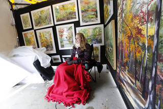 Oklahoma City artist Kathryn Bray sits in her booth at the Festival of the Arts in Oklahoma City , Tuesday April 23, 2013. Photo By Steve Gooch, The Oklahoman ORG XMIT: OKC1303121532440650