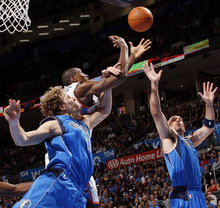 Dallas' Dirk Nowitzki (41), Oklahoma City's Serge Ibaka (9) and Dallas' Jason Kidd (2) chase a rebound during the NBA basketball game between the Oklahoma City Thunder and the Dallas Mavericks at Chesapeake Energy Arena in Oklahoma City, Monday, March 5, 2012. The Thunder won, 95-91. Photo by Nate Billings, The Oklahoman