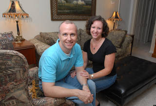 """FILE - In this Thursday, May 11, 2006 file photo, Alan Chambers, left, president of Exodus International, sits with his wife, Leslie, in their home in Winter Park, Fla. The president of the country's best-known Christian ministry dedicated to helping people repress same-sex attraction through prayer is trying to distance the group from the idea that gay people's sexual orientation can be permanently changed or """"cured."""" Chambers said Tuesday, June 26, 2012 that their upcoming national conference would highlight his efforts to dissociate the group from the controversial practice usually called ex-gay, reparative or conversion therapy. (AP Photo/Phelan M. Ebenhack)"""