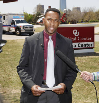 Oklahoma City police Capt. Dexter Nelson reports Monday that Oklahoma City police officer Chad Peery died shortly after noon Monday from injuries he suffered in a crash Sunday evening on Interstate 40. Nelson made the statement at OU Medical Center in Oklahoma City. Photo by Paul B. Southerland, The Oklahoman