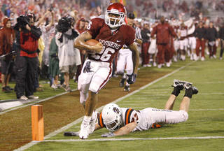 OU freshman Jonathan Miller scores a touchown against Idaho State. Photo by Bryan Terry, The Oklahoman