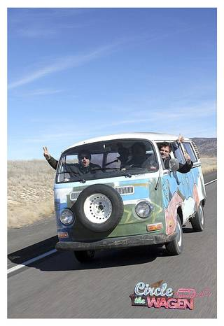 """Here is the """"The Croc"""" as it looks today. Ryan Green, director of """"Circle the Wagen,"""" is on the left waving a peace sign out the window. In the middle of the van is passenger Charlie Pecoraro, 32, of Burbank, Calif. The driver is Dave Torstenson, 32, of Los Angeles. Leslie Andrew Ridings"""