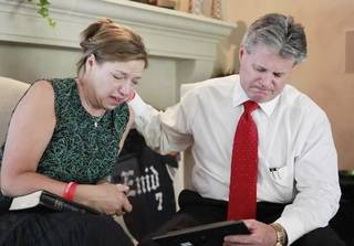 """In this Monday, July 11, 2011 file photo, Gail and Craig Box discuss the loss of their son, Oklahoma football player Austin Box, at their home in Enid, Okla. Craig and Gail Box, the parents of Oklahoma linebacker Austin Box, say they have information that could help police investigating his death. They say there were """"stark"""" text messages on their son's cellphone that suggest at least two people know who was supplying him with pain pills before his death last May at the age of 22. The Boxes have turned the information over to police in El Reno, Okla., who will not discuss their investigation. (AP Photo/The Oklahoman, David McDaniel, File)"""