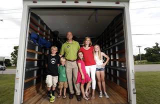 Chance Wilson, Holt Wilson, Andrew Wilson, Izzy Wilson, Krista Wilson and Ellie Wilson pose in the company's moving van. The family is expanding its Tulsa moving business to Oklahoma City. Photo by Sarah Phipps, The Oklahoman SARAH PHIPPS - SARAH PHIPPS