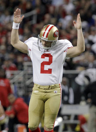 San Francisco 49ers place kicker David Akers celebrates after throwing a touchdown pass to Michael Crabtree on a fake field goal attempt during the third quarter of an NFL football game against the St. Louis Rams Sunday, Jan. 1, 2012, in St. Louis. (AP Photo/Seth Perlman) ORG XMIT: MOJR123
