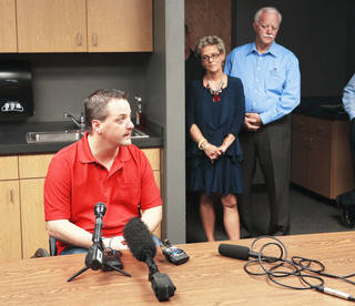 Oklahoma City police officer Chad Peery speaks in a news conference Thursday as his parents, Jan and Greg Peery, listen. PHOTO BY SARAH PHIPPS, THE OKLAHOMAN