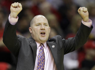 OU will have to pony up if it wants a coach like Marquette's Buzz Williams. AP photo