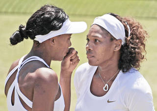 The Williams sisters — Venus, left, and Serena — will play for the women's title during Saturday's Breakfast at Wimbledon. AP PHOTO