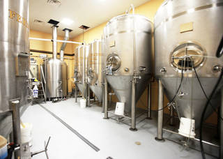The brewhouse at the OKCity Brewing Cooperative is shown. Mustang Brewing Co. announced it has reached an agreement to buy the cooperative and move some of its production to the facility. Photo by Paul Hellstern, The OKLAHOMAN ARCHIVES