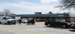 Oklahoma City police investigate a homicide Thursday afternoon at 5916 NW 16. A person was found shot in a shopping center parking lot. This is Oklahoma City's 16th homicide in 2013. Photo by LeighAnne Manwarren, The Oklahoman