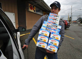 Andy Wagar loads Hostess products into a van outside the Wonder Bakery Thrift Shop in Bellingham, Wash., Friday, after Hostess Brands Inc. said it would shutter its operations after years of struggling with management turmoil, rising labor costs and the ever-changing tastes of Americans even as its pantry of sugary cakes seemed suspended in time. AP PHOTO Philip A. Dwyer - AP