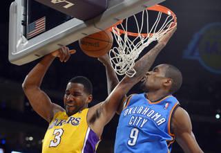 Oklahoma City Thunder forward Serge Ibaka, of Congo, blocks the shot of Los Angeles Lakers forward Shawne Williams, left, during the first half of an NBA basketball game Thursday, Feb. 13, 2014, in Los Angeles. (AP Photo/Mark J. Terrill)