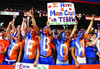 ** FILE ** In this Sept. 6, 2008 file photo, Florida Gator fans root for their quarterback Tim Tebow during an NCAA college football game between Florida and Miami in Gainesville, Fla. The Southeastern Conference sure seems full of itself at times, strutting around touting itself as the best college football conference in the country, hands down. Then again, SEC teams have won the last two national championships, and Florida could make it three in a row Thursday night. (AP Photo/Reinhold Matay, File)