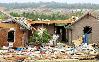 Friends are removing items from Scott and Lisa Thiels home Tuesday, a day after a tornado damaged homes in the Deerfield Estates and Deerfield Estates West additions south of Interstate 40 and Choctaw Road. Photo by Jim Beckel, The Oklahoman