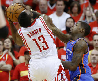 NBA BASKETBALL: Oklahoma City's DeAndre Liggins (25) defends Houston's James Harden (13) during Game 6 in the first round of the NBA playoffs between the Oklahoma City Thunder and the Houston Rockets at the Toyota Center in Houston, Texas, Friday, May 3, 2013. Photo by Bryan Terry, The Oklahoman