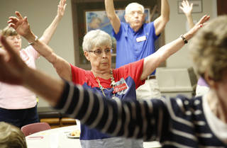 Juanita Roberts, 78, of Oklahoma City, exercises recently at St. John the Baptist Church in Edmond. Roberts tries to stay active to better ensure she stays healthy in spite of chronic obstructive pulmonary disease and a recent open-heart surgery. PHOTO BY STEVE GOOCH, THE OKLAHOMAN Steve Gooch - The Oklahoman