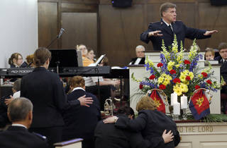 Commissioner David Jeffrey preaches as people pray during the Salvation Army Central Oklahoma Soldiers' Rally in Oklahoma City, Saturday, March 22, 2013. Photo by Sarah Phipps, The Oklahoman
