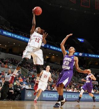 Oklahoma guard Danielle Robinson (13) shoots in front of James Madison guard Tarik Hislop (22) during in the first round of the NCAA women's college basketball tournament, Sunday, March 20, 2011, in Charlottesville, Va. Oklahoma won 86-72. Robinson scored 19 points. (AP Photo/Andrew Shurtleff) Andrew Shurtleff