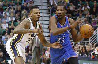 OKC's Kevin Durant, right, is defended by Utah's Brandon Rush during first half action in Salt Lake City on Tuesday. Durant scored 48 points in a 112-101 loss. AP Photo
