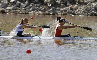 Kaitlyn McElroy, left, and Maggie Hogan compete in the women's double kayak 500 meters final during the 2012 USA Canoe/Kayak World Cup Team Trials on the Oklahoma River. By Sarah Phipps, The Oklahoman. SARAH PHIPPS - SARAH PHIPPS
