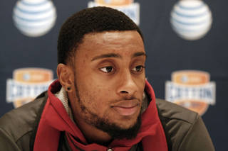 Oklahoma junior defensive back Aaron Colvin answers questions during a press conference for the Cotton Bowl NCAA college football at the Omni Mandalay hotel, Tuesday, Jan. 1, 2013, in Irving, Texas. Oklahoma plays Texas A&M on Jan. 4 in the Cotton Bowl in Arlington, Texas. (AP Photo/Brandon Wade) ORG XMIT: TXBW118