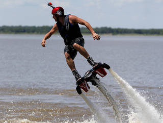 Jeff Luft, with Gulf State Flyboard,rides a Zapata Flyboard on Lake Overholser on Tuesday. Photo by Bryan Terry, The Oklahoman Bryan Terry - THE OKLAHOAMN