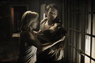 """This film image released by Summit Entertainment shows, Juliet Rylance, left, Ethan Hawke, right, and Michael Hall D'Addario in a scene from """"Sinister."""" AP Photo/Summit Entertainment"""