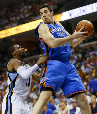 Oklahoma City's Nick Collison (4) looks over Memphis' Mike Conley (11) during Game 4 of the second-round NBA basketball playoff series between the Oklahoma City Thunder and the Memphis Grizzlies at FedExForum in Memphis, Tenn., Monday, May 13, 2013. Photo by Nate Billings, The Oklahoman