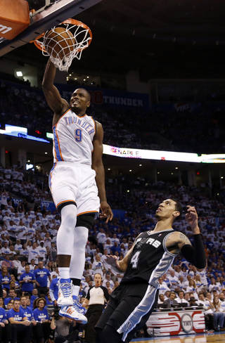 Oklahoma City's Serge Ibaka (9) dunks in front of San Antonio's Danny Green (4) during Game 4 of the Western Conference Finals in the NBA playoffs between the Oklahoma City Thunder and the San Antonio Spurs at Chesapeake Energy Arena in Oklahoma City, Tuesday, May 27, 2014. Photo by Nate Billings, The Oklahoman