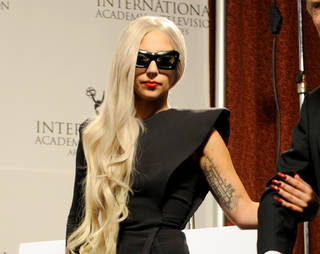 Lady Gaga wears her nails long, pointed and in dramatic shades of deep red, metallics and black. Photo provided.