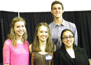 Edmond Rotary Club scholarship winners are, from left, Aubrey Haas, Tessa Goetz, Travis Christensen and Annamarie Jiwa. Selections were based primarily on community service. PHOTO PROVIDED BY CAROL HARTZOG