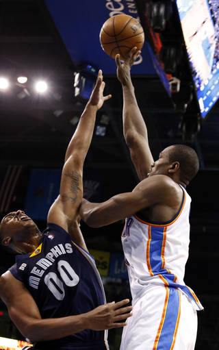 Oklahoma City's Serge Ibaka (9) shoots over Memphis' Darrell Arthur during Game 1 in the second round of the NBA playoffs between the Oklahoma City Thunder and the Memphis Grizzlies at Chesapeake Energy Arena in Oklahoma City, Sunday, May 5, 2013. Photo by Sarah Phipps, The Oklahoman