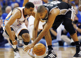 Oklahoma City's Thabo Sefolosha (2) and San Antonio's Tim Duncan (21) chase a loose ball during Game 3 of the Western Conference Finals between the Oklahoma City Thunder and the San Antonio Spurs in the NBA playoffs at the Chesapeake Energy Arena in Oklahoma City, Thursday, May 31, 2012. Oklahoma City won, 102-82. Photo by Nate Billings, The Oklahoman