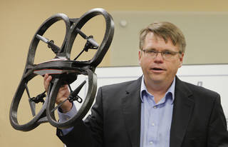 James Grimsley, president and CEO of Design Intelligence Incorporated, holds up a quad copter while talking about drone research and development in Oklahoma during a meeting at the Tinker Business and Industrial Park Monday, April 28, 2014. Photo by Paul B. Southerland, The Oklahoman PAUL B. SOUTHERLAND - PAUL B. SOUTHERLAND