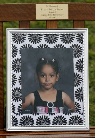 A bench with kindergarten student Evelyn De Los Santos' name and photograph was presented during a memorial at Eugene Field Elementary School in Oklahoma City, Friday, May 11, 2012. Evelyn was murdered by her father in March 2012. Photo By Steve Gooch, The Oklahoman