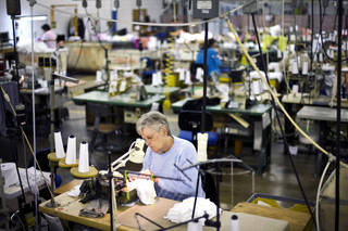 Vanessa Lagola works recently at her sewing machine at FesslerUSA apparel manufacturer in Orwigsburg, Pa. U.S. manufacturing expanded for the second straight month in October. AP Photos