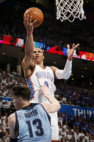 Oklahoma City's Russell Westbrook (0) goes over Memphis' Mike Miller (13) to the basket during Game 2 in the first round of the NBA playoffs between the Oklahoma City Thunder and the Memphis Grizzlies at Chesapeake Energy Arena in Oklahoma City, Monday, April 21, 2014. Photo by Nate Billings, The Oklahoman