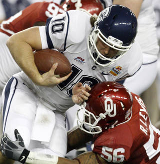 Oklahoma's Ronnell Lewis (56) brings down Connecticut's Zach Frazer (10)during the Fiesta Bowl college football game between the University of Oklahoma Sooners and the University of Connecticut Huskies in Glendale, Ariz., at the University of Phoenix Stadium on Saturday, Jan. 1, 2011. Photo by Bryan Terry, The Oklahoman