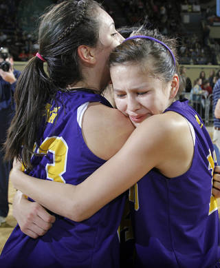 Anadarko's Lakota Beatty (23) and Kylie Parker (12) celebrate the win over Ft. Gibson during the 4A girls State Basketball Championship game between Ft. Gibson High School and Anadarko High School at State Fair Arena on Saturday, March 10, 2012 in Oklahoma City, Okla. Photo by Chris Landsberger, The Oklahoman