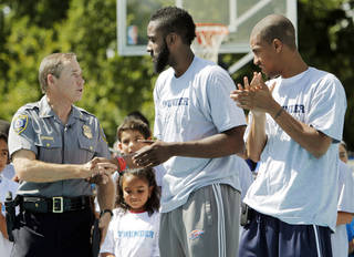 Oklahoma City Police Chief Bill Citty shakes hands with James Harden, a player for the Oklahoma City Thunder, next to Eric Maynor, also a Thunder player, during the dedication of the basketball court at the Police Athletic League (PAL) Community Center, 3816 S. Robinson, in Oklahoma City, Saturday, Sept. 25, 2010. Photo by Nate Billings, The Oklahoman