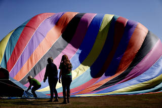 University of Central Oklahoma students with the Student Programming Board help inflate a hot air balloon before offering rides to students and faculty.